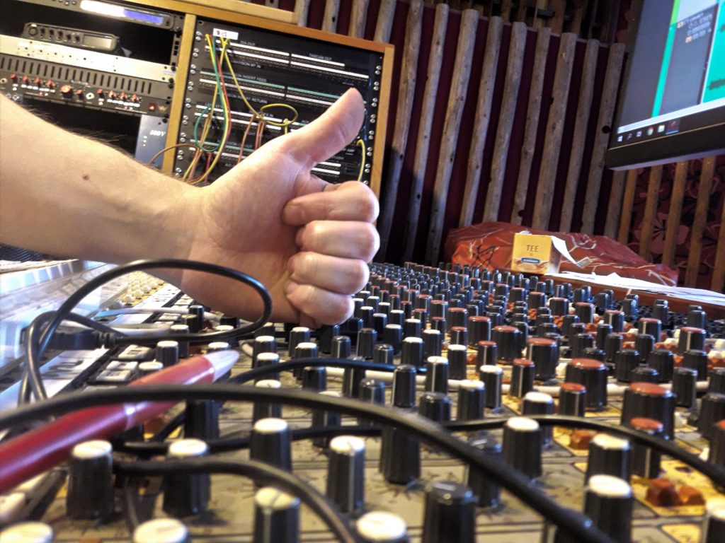 Thumbs up for the mixer board at Astral Studios